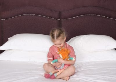 girl on comfy double-bed