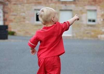 Child enjoying the outside at Beech House Holidays